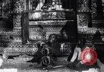 Image of Man sings and plays a saranqi at a temple India, 1953, second 10 stock footage video 65675028606
