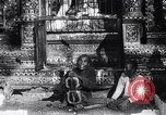 Image of Man sings and plays a saranqi at a temple India, 1953, second 12 stock footage video 65675028606