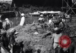 Image of Men digging clay from a river bank India, 1953, second 1 stock footage video 65675028607