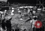 Image of Men digging clay from a river bank India, 1953, second 2 stock footage video 65675028607