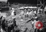 Image of Men digging clay from a river bank India, 1953, second 3 stock footage video 65675028607