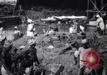 Image of Men digging clay from a river bank India, 1953, second 4 stock footage video 65675028607