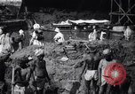 Image of Men digging clay from a river bank India, 1953, second 5 stock footage video 65675028607
