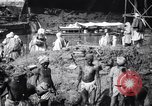 Image of Men digging clay from a river bank India, 1953, second 7 stock footage video 65675028607
