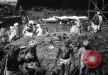 Image of Men digging clay from a river bank India, 1953, second 8 stock footage video 65675028607