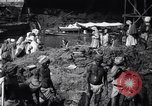 Image of Men digging clay from a river bank India, 1953, second 9 stock footage video 65675028607