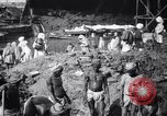 Image of Men digging clay from a river bank India, 1953, second 10 stock footage video 65675028607