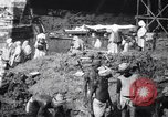 Image of Men digging clay from a river bank India, 1953, second 11 stock footage video 65675028607