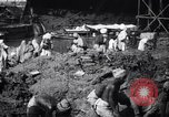Image of Men digging clay from a river bank India, 1953, second 12 stock footage video 65675028607