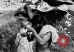 Image of Hindu pilgrims bathe while on journey to Ganges river source India, 1939, second 11 stock footage video 65675028617