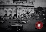 Image of Approach to the Old Howrah  bridge  Calcutta India, 1929, second 4 stock footage video 65675028626