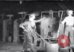 Image of industrial workers at ingot-furnace United States USA, 1920, second 1 stock footage video 65675028691