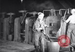 Image of industrial workers at ingot-furnace United States USA, 1920, second 2 stock footage video 65675028691
