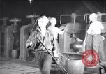 Image of industrial workers at ingot-furnace United States USA, 1920, second 3 stock footage video 65675028691