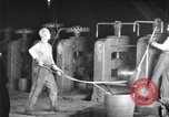 Image of industrial workers at ingot-furnace United States USA, 1920, second 5 stock footage video 65675028691