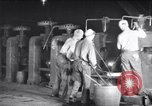 Image of industrial workers at ingot-furnace United States USA, 1920, second 7 stock footage video 65675028691