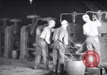 Image of industrial workers at ingot-furnace United States USA, 1920, second 8 stock footage video 65675028691