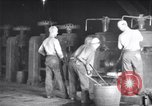 Image of industrial workers at ingot-furnace United States USA, 1920, second 9 stock footage video 65675028691