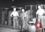 Image of industrial workers at ingot-furnace United States USA, 1920, second 10 stock footage video 65675028691