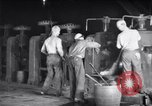 Image of industrial workers at ingot-furnace United States USA, 1920, second 11 stock footage video 65675028691
