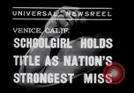 Image of Relna Brewster wrestles male opponent Venice Beach Los Angeles California USA, 1938, second 1 stock footage video 65675028765
