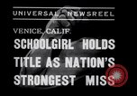 Image of Relna Brewster wrestles male opponent Venice Beach Los Angeles California USA, 1938, second 7 stock footage video 65675028765