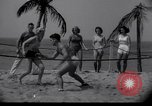 Image of Relna Brewster wrestles male opponent Venice Beach Los Angeles California USA, 1938, second 12 stock footage video 65675028765
