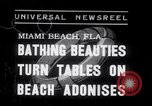 Image of Beach patrol officials and swimsuit models Miami Beach Florida USA, 1938, second 1 stock footage video 65675028768