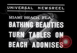 Image of Beach patrol officials and swimsuit models Miami Beach Florida USA, 1938, second 2 stock footage video 65675028768