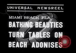 Image of Beach patrol officials and swimsuit models Miami Beach Florida USA, 1938, second 4 stock footage video 65675028768