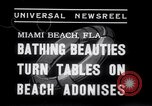 Image of Beach patrol officials and swimsuit models Miami Beach Florida USA, 1938, second 8 stock footage video 65675028768