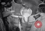 Image of Bessie Pastor and husband Michael Berliney create synthetic ice Toledo Ohio USA, 1938, second 9 stock footage video 65675028777