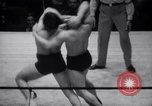 Image of Kimon Kudo beats Jesse James in wrestling New York United States USA, 1938, second 10 stock footage video 65675028783
