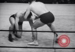 Image of Kimon Kudo beats Jesse James in wrestling New York United States USA, 1938, second 12 stock footage video 65675028783