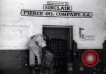Image of Government's Oil Posters pasted on other companies oil posters Mexico, 1938, second 2 stock footage video 65675028791