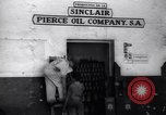 Image of Government's Oil Posters pasted on other companies oil posters Mexico, 1938, second 4 stock footage video 65675028791