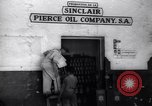 Image of Government's Oil Posters pasted on other companies oil posters Mexico, 1938, second 6 stock footage video 65675028791