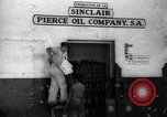 Image of Government's Oil Posters pasted on other companies oil posters Mexico, 1938, second 7 stock footage video 65675028791