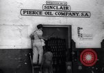 Image of Government's Oil Posters pasted on other companies oil posters Mexico, 1938, second 8 stock footage video 65675028791
