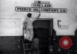 Image of Government's Oil Posters pasted on other companies oil posters Mexico, 1938, second 10 stock footage video 65675028791