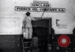 Image of Government's Oil Posters pasted on other companies oil posters Mexico, 1938, second 11 stock footage video 65675028791