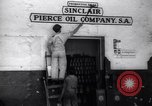 Image of Government's Oil Posters pasted on other companies oil posters Mexico, 1938, second 12 stock footage video 65675028791