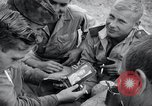 Image of US-Russian soldiers listen guitar Kaesong Korea 38th Parallel, 1945, second 6 stock footage video 65675028819