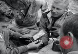 Image of US-Russian soldiers listen guitar Kaesong Korea 38th Parallel, 1945, second 7 stock footage video 65675028819