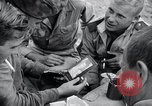 Image of US-Russian soldiers listen guitar Kaesong Korea 38th Parallel, 1945, second 8 stock footage video 65675028819