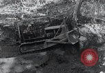 Image of Bulldozer clears road Burma, 1943, second 1 stock footage video 65675028820
