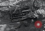 Image of Bulldozer clears road Burma, 1943, second 2 stock footage video 65675028820