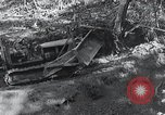 Image of Bulldozer clears road Burma, 1943, second 7 stock footage video 65675028820