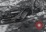Image of Bulldozer clears road Burma, 1943, second 8 stock footage video 65675028820