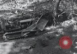 Image of Bulldozer clears road Burma, 1943, second 10 stock footage video 65675028820